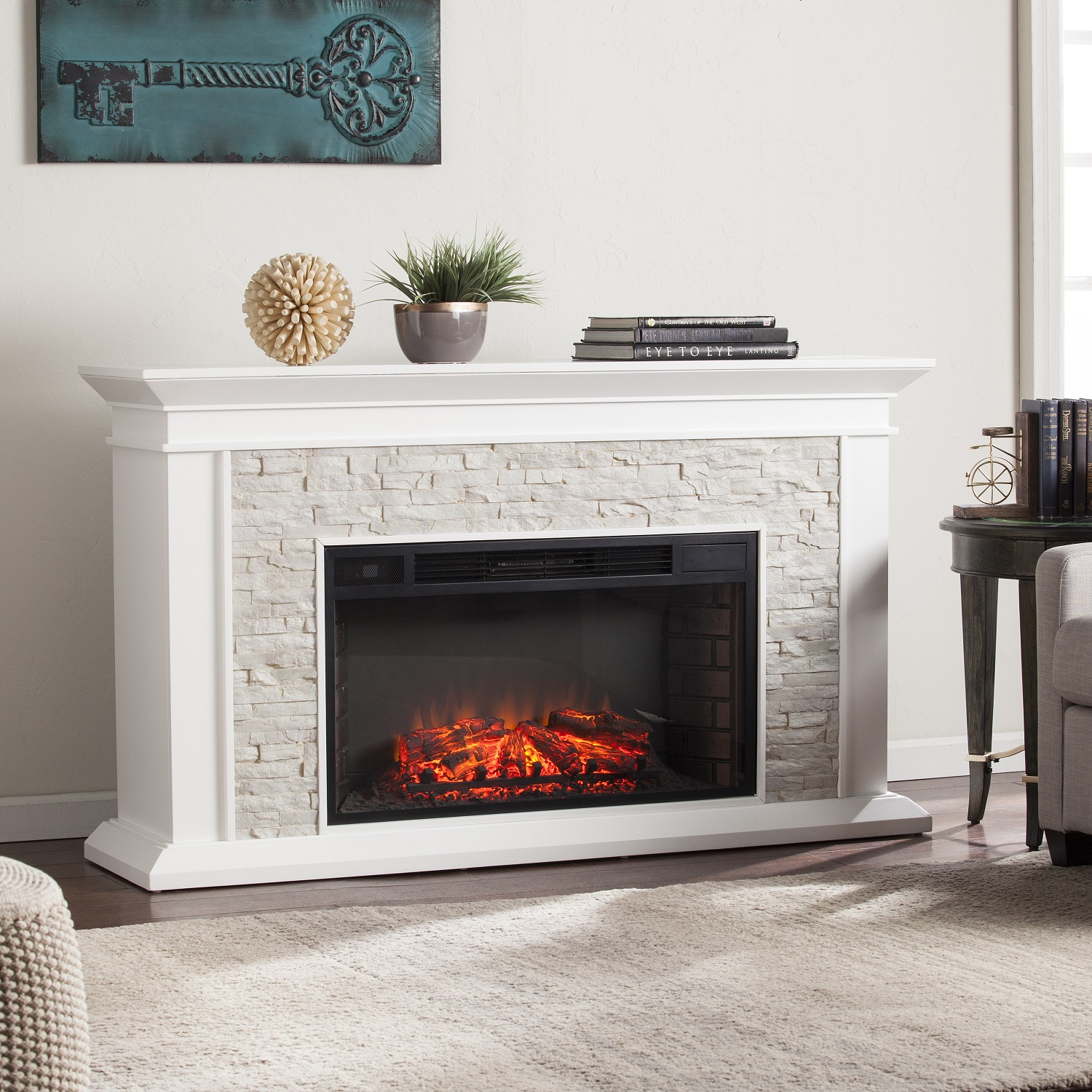 Western romanticism warms to life in this striking electric fireplace. Crisp white finish highlights subtle woodwork; rustic white faux stacked stone encases the firebox.