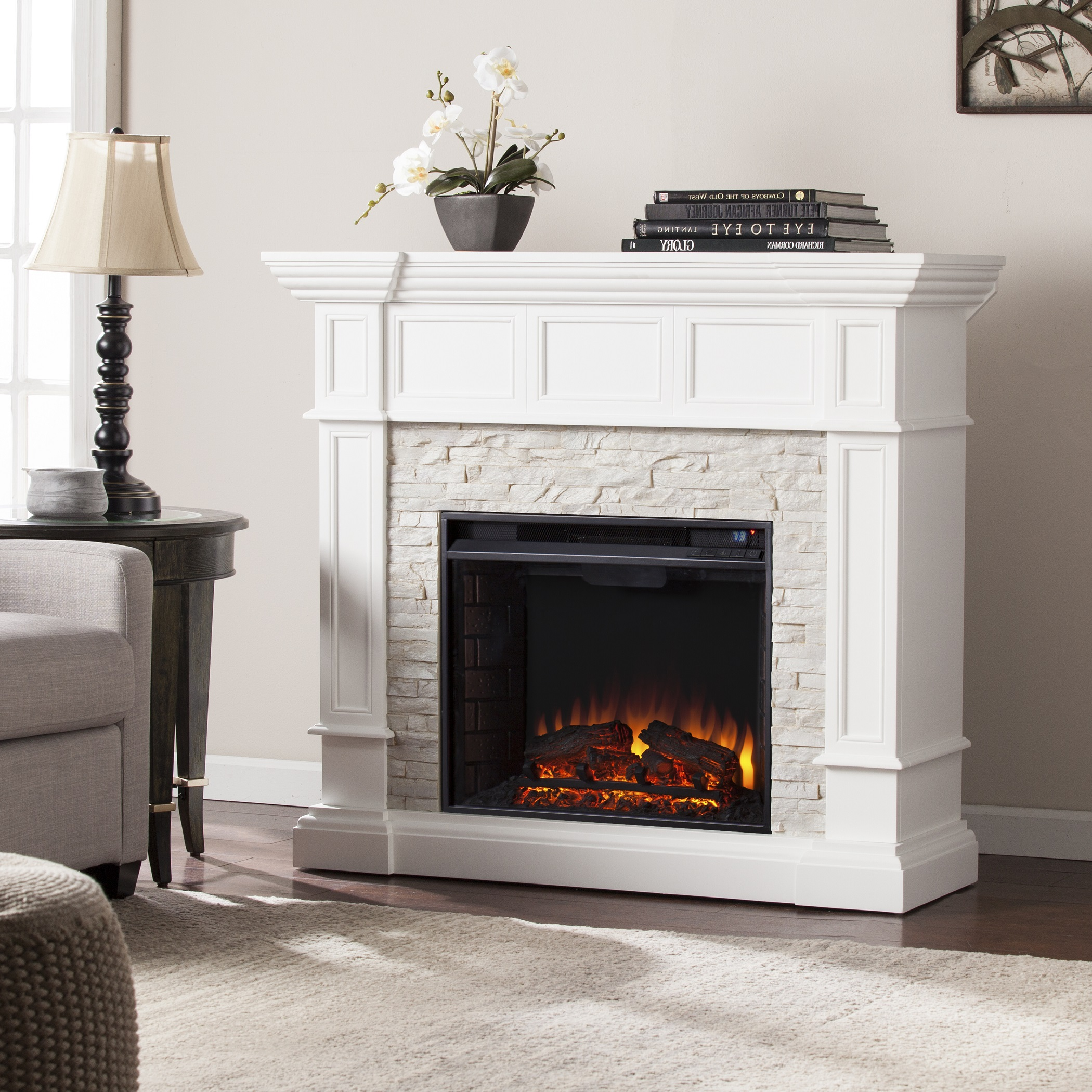 Rustic cottage chic comes to life in this crisp white electric fireplace. Dimensional woodwork adorns the pilasters