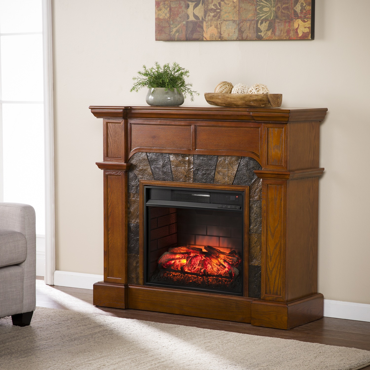 Bring your decor to life with this charming infrared electric fireplace. Linear woodwork forms a clean silhouette