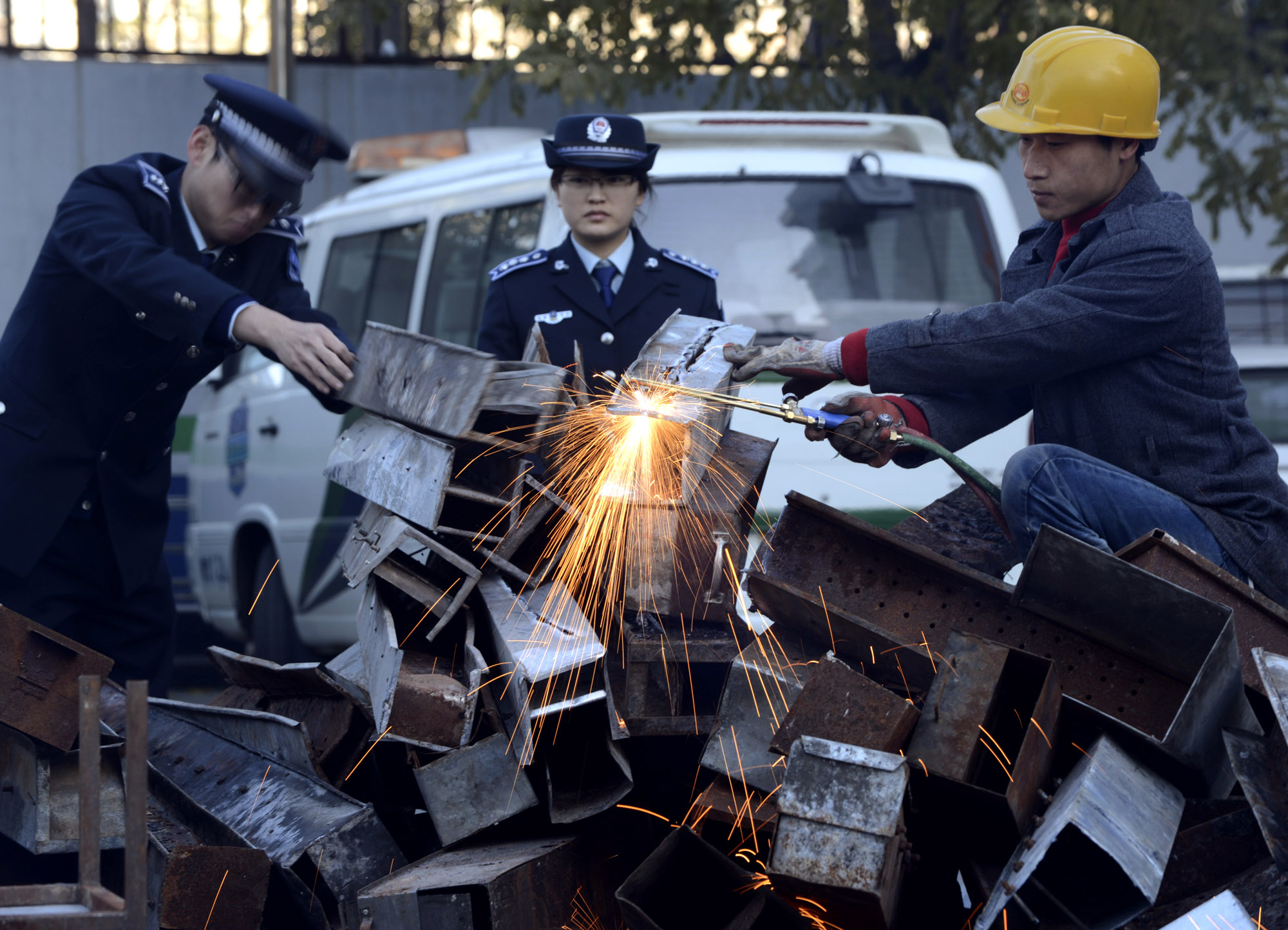 Chinese Officials Destroying Outdoor Grills