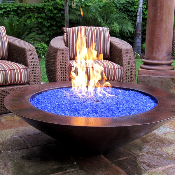 What is Fire Glass? Fire glass is composed of small bits of tempered glass that is used in fireplaces and fire pits. A glowing fire and ice combination.